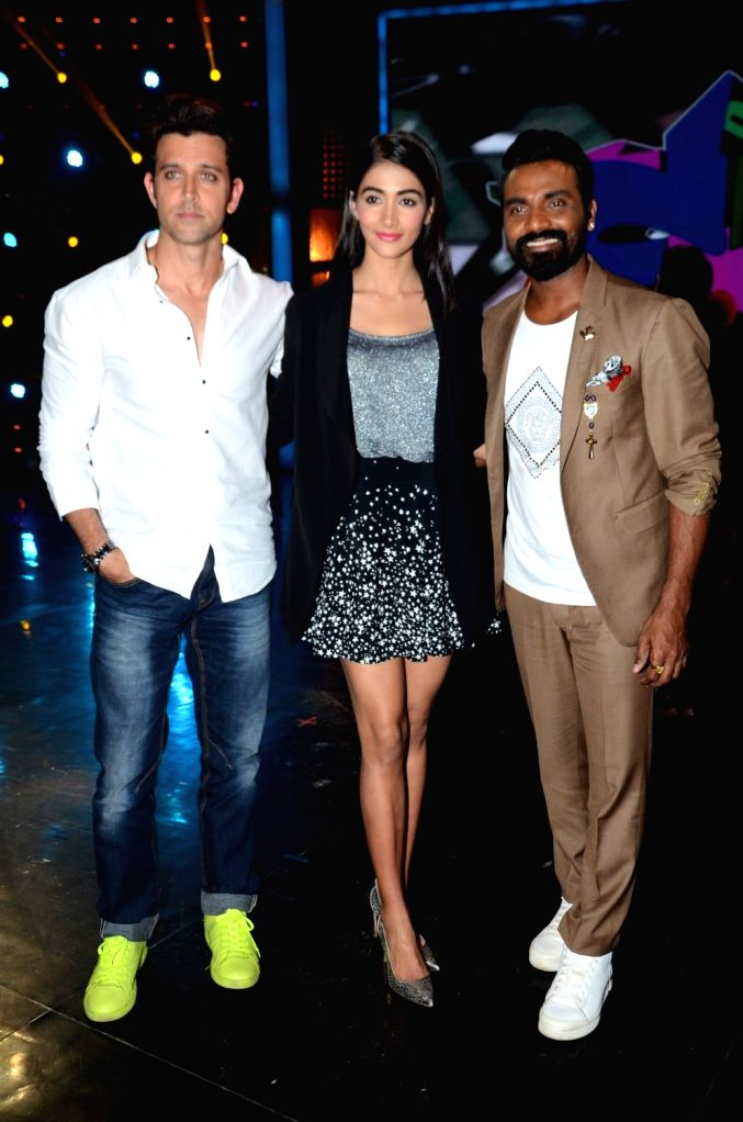 Actors Hrithik Roshan, Pooja Hedge and choreographer Remo D`Souza on the sets of dance reality show Dance + 2 during the promotion of film Mohenjo Daro in Mumbai, on Aug 3, 2016. - Hrithik Roshan and Pooja Hedge