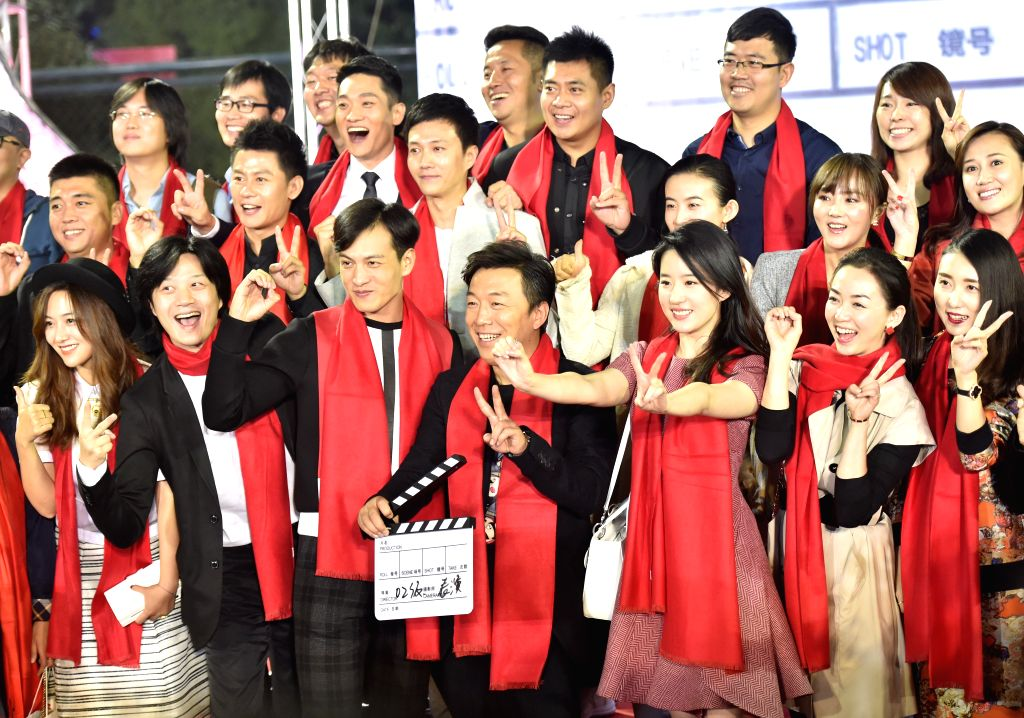 Actors Huang Bo (C front) and Liu Yifei (3rd R, front) poses with students for photos during a celebration in Beijing Film Academy in Beijing, China, Oct. 17, 2015. ... - Huang B