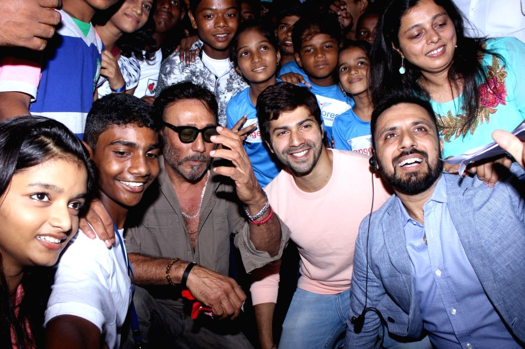 Actors Jackie Shroff and Varun Dhawan during the opening ceremony of India alive Short Film Festival 2017 in Mumbai, on May 30, 2017. - Jackie Shroff and Varun Dhawan