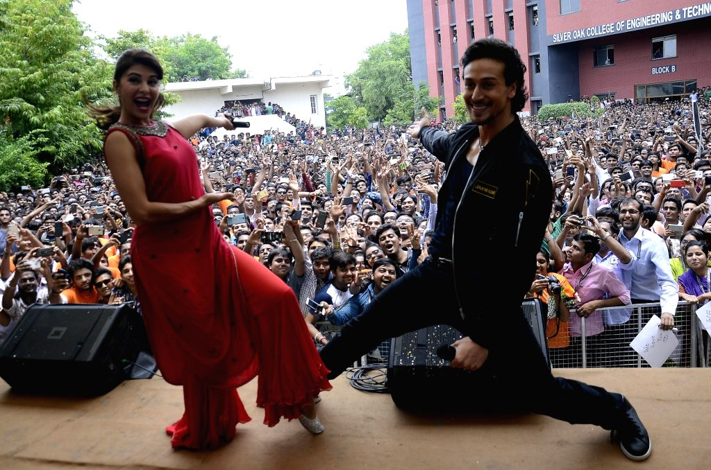 """Actors Jacqueline Fernandez and Tiger Shroff perform during the promotion of their upcoming film """"A Flying Jatt"""" in Ahmedabad on Aug 4, 2016. - Jacqueline Fernandez and Tiger Shroff"""