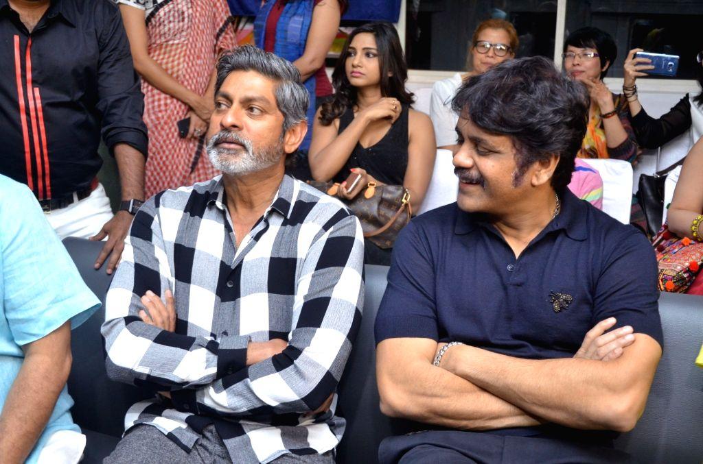 Actors Jagapati Babu and Akkineni Nagarjuna during the launch of Colossal Abstracts by Bharat Thakur's Art Exhibition. - Jagapati Babu and Akkineni Nagarjuna