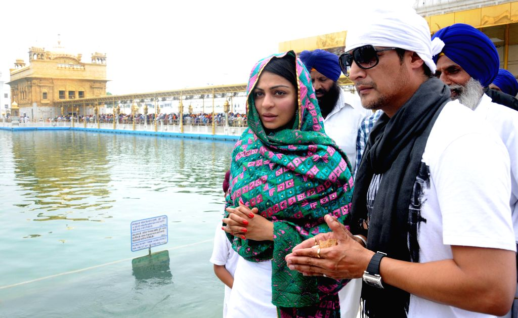 Actors Jimmy Shergill and Neeru Bajwa pay obeisance at the Golden Temple in Amritsar on Aug 3, 2014.