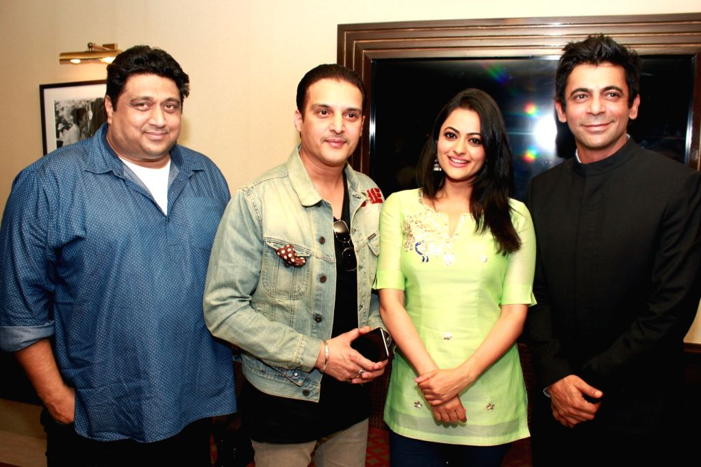 """Actors Jimmy Shergill, Shruti Sodhi, Sunil Grover and producer Rajesh Banga during a press conference to promote their upcoming Punjabi film """"Vaisakhi List"""" in New Delhi on April ... - Jimmy Shergill, Shruti Sodhi and Sunil Grover"""
