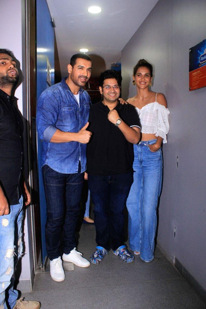 "Actors John Abraham, Aisha Sharma and director Milap Zaveri during the promotion of their upcoming film ""Satyameva Jayate"" in Mumbai on July 13, 2018. - Milap Zaveri, John Abraham and Aisha Sharma"