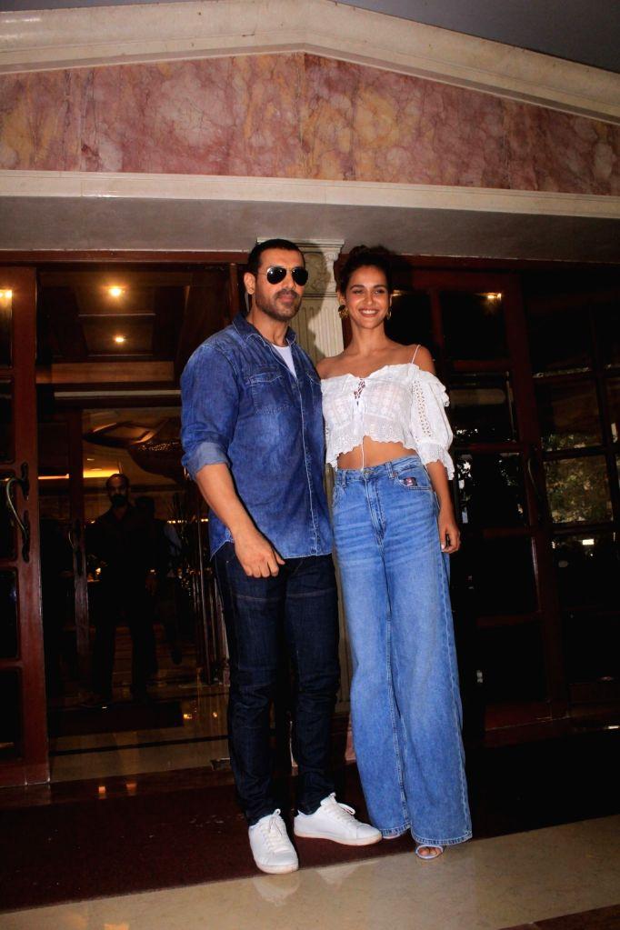 "Actors John Abraham and Aisha Sharma during the promotion of their upcoming film ""Satyameva Jayate"" in Mumbai on July 13, 2018. - John Abraham and Aisha Sharma"