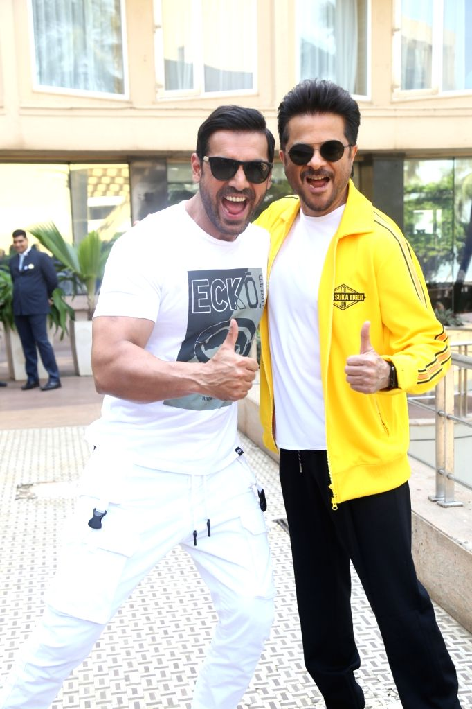 """Actors John Abraham and Anil Kapoor during the promotions of their upcoming film """"Pagalpanti"""" in Mumbai on Nov 14, 2019. - John Abraham and Anil Kapoor"""