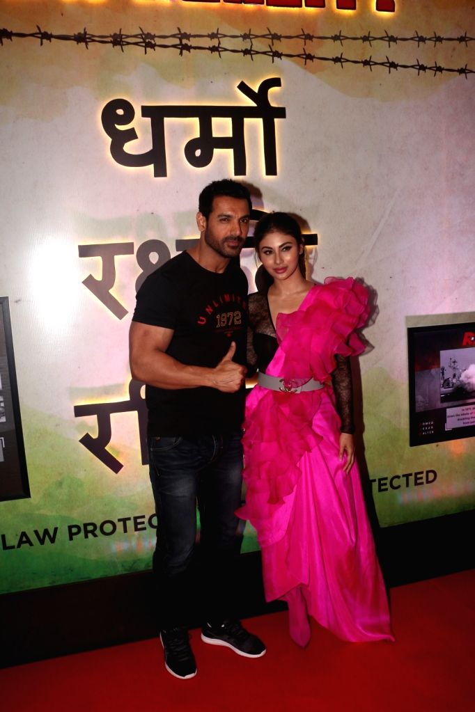 """Actors John Abraham and Mouni Roy at the trailer launch of their upcoming film """"Romeo Akbar Walter"""", in Mumbai, on March 4, 2019. - John Abraham and Mouni Roy"""