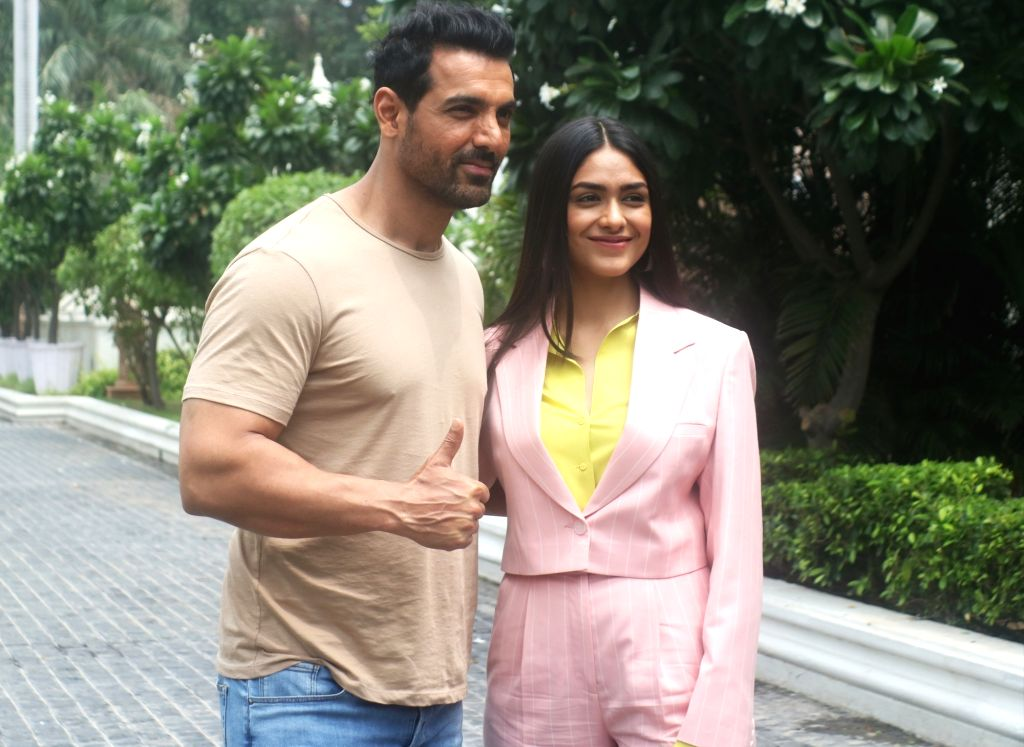 """Actors John Abraham and Mrunal Thakur during the promotions of their upcoming film """"Batla House"""" in New Delhi on Aug 3, 2019. - John Abraham and Mrunal Thakur"""