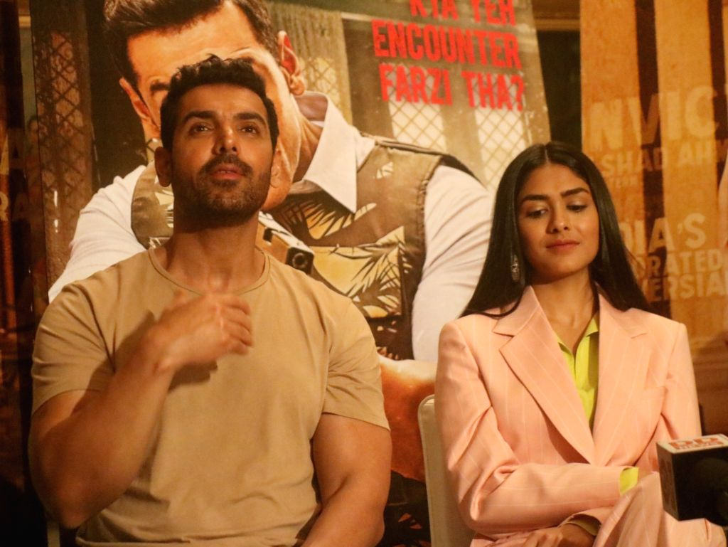 "Actors John Abraham and Mrunal Thakur interact with media persons during the promotions of their upcoming film ""Batla House"", in New Delhi on Aug 3, 2019. - John Abraham and Mrunal Thakur"