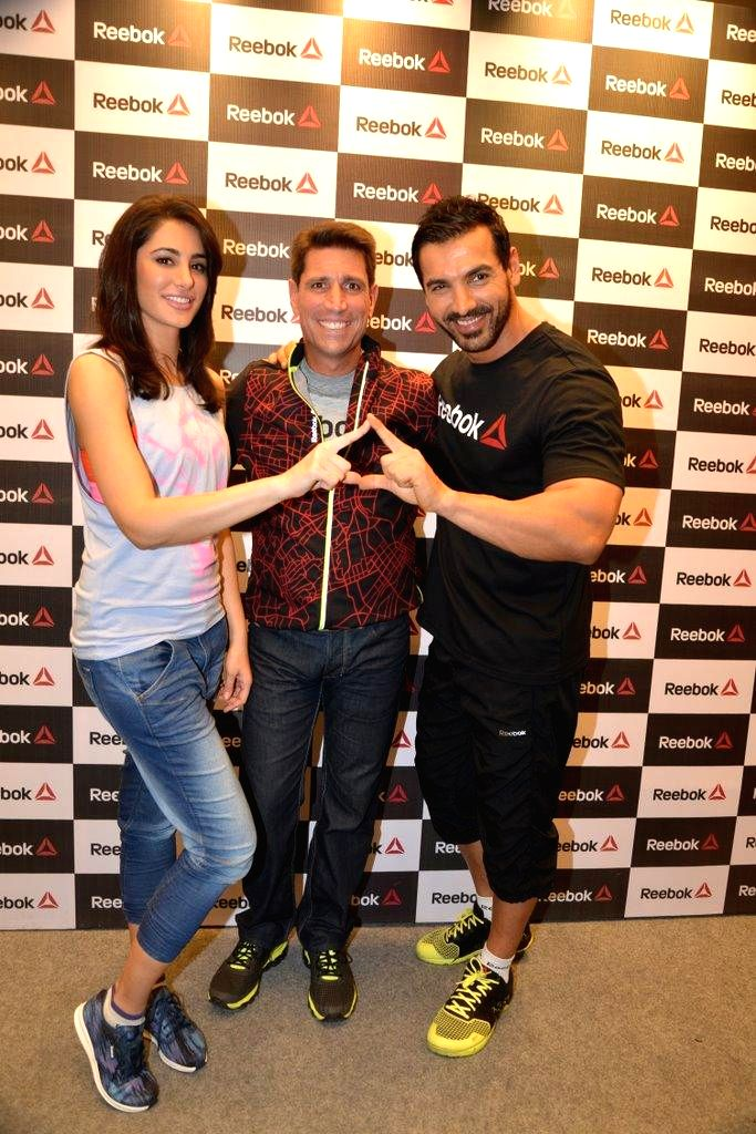 Actors John Abraham and Nargis Fakhri during the launch of Reebok Fithub store and studio in Mumbai, on Sep. 01, 2014. - John Abraham and Nargis Fakhri