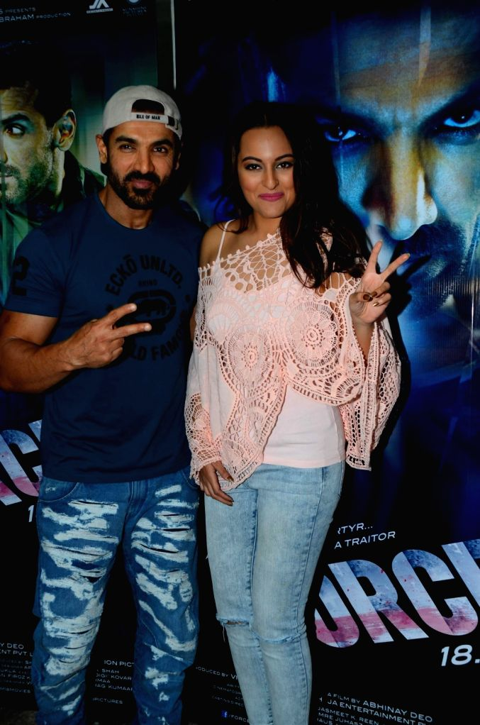 Actors John Abraham and Sonakshi Sinha during media interaction of the film Force 2, in Mumbai, on Nov 18, 2016. - John Abraham and Sonakshi Sinha