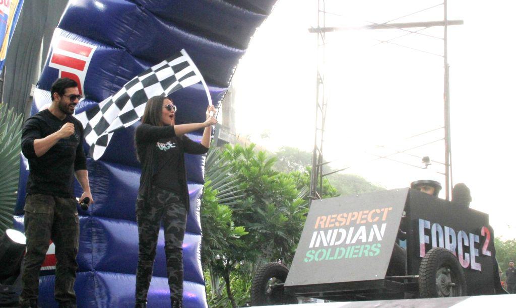 Actors John Abraham and Sonakshi Sinha during the Red Bull Soapbox Race 2016 in Mumbai on Nov 13, 2016. - John Abraham and Sonakshi Sinha