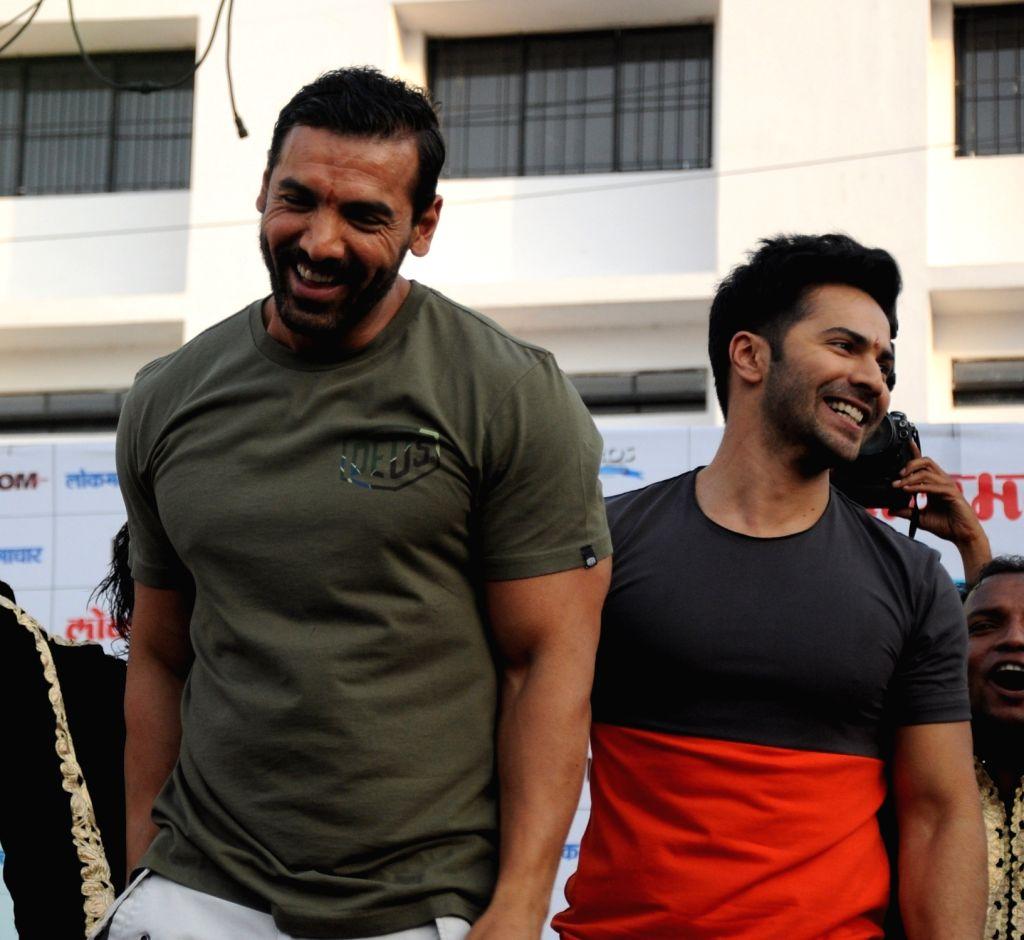 "Actors John Abraham and Varun Dhawan during a programme organised to promote their upcoming film ""Dishoom"" in Nagpur, on June 24, 2016. - John Abraham and Varun Dhawan"
