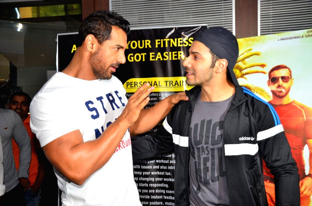 Actors John Abraham and Varun Dhawan during the promotion of film Dishoom at Gold's Gym in Mumbai on July 9, 2016. - John Abraham and Varun Dhawan