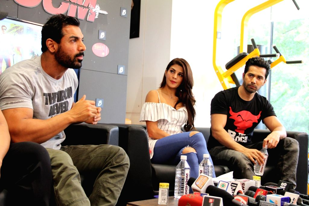 "Actors John Abraham, Jacqueline Fernandes and ​Varun Dhawan during the promotion of their upcoming film ""Dishoom"" in Ahmedabad on July 27, 2016. - John Abraham and Jacqueline Fernandes"