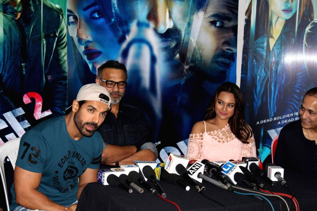 Actors John Abraham, Sonakshi Sinha,filmmakers Vipul Shah and Abhinay Deo during media interaction of the film Force 2, in Mumbai, on Nov 18, 2016. - John Abraham, Sonakshi Sinha and Vipul Shah