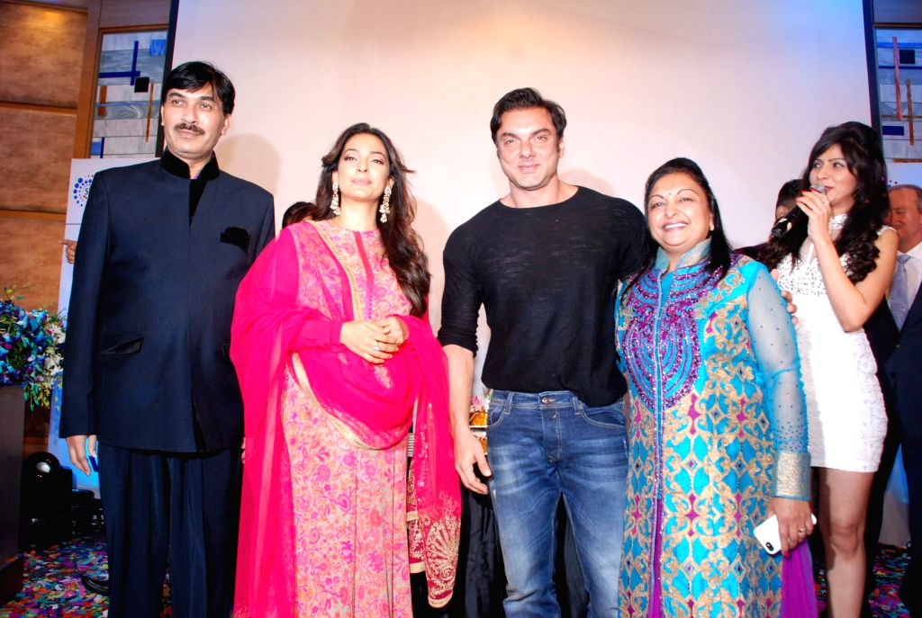 Actors Juhi Chawla and Sohail Khan during the launch of beauty care system `Purwave` in Mumbai, on Aug 29, 2014.