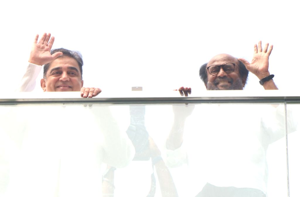 Actors Kamal Hassan and Rajinikanth wave at fans during the inauguration of the statue of late film director K. Balachandar at the new office premises of Raaj Kamal Films International, in ... - K. Balachandar, Kamal Hassan and Rajinikanth