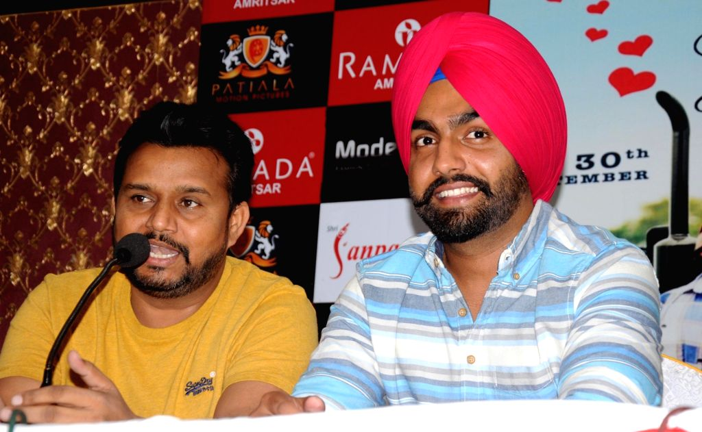 "Actors Karamjit Anmol and Ammy Virk during a press conference to promote of their upcoming Punjabi film ""Nikka Zaildar"" in Amritsar on Sept 26, 2016. - Karamjit Anmol and Ammy Virk"