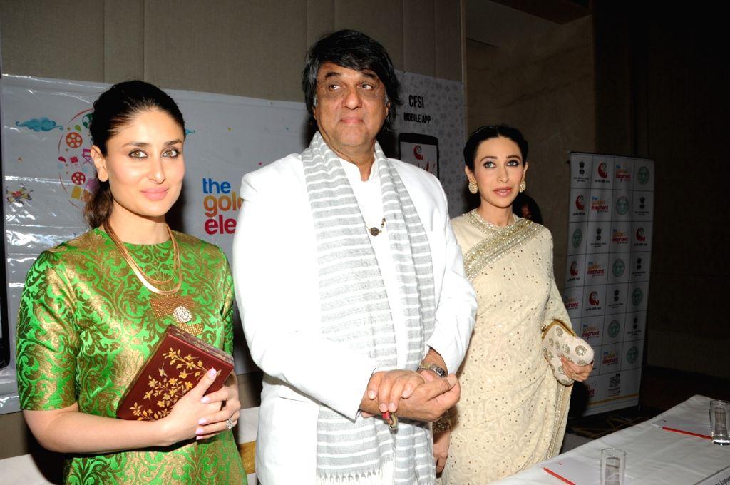 Actors Karishma Kapoor, Kareena Kapoor and Mukesh Khanna during a programme in Hyderabad on Nov 14, 2015. - Karishma Kapoor and Mukesh Khanna