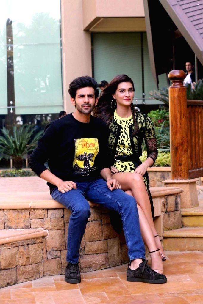 "Actors Kriti Sanon and Kartik Aryan during a media interaction for their upcoming film ""Luka Chuppi"" in Mumbai on Feb 18, 2019. - Kriti Sanon and Kartik Aryan"