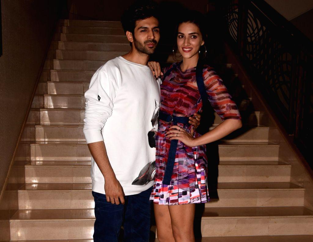 "Actors Kriti Sanon and Kartik Aryan during a programme organised to promote their upcoming film ""Luka Chuppi"" in Mumbai on Feb 18, 2019. - Kriti Sanon and Kartik Aryan"