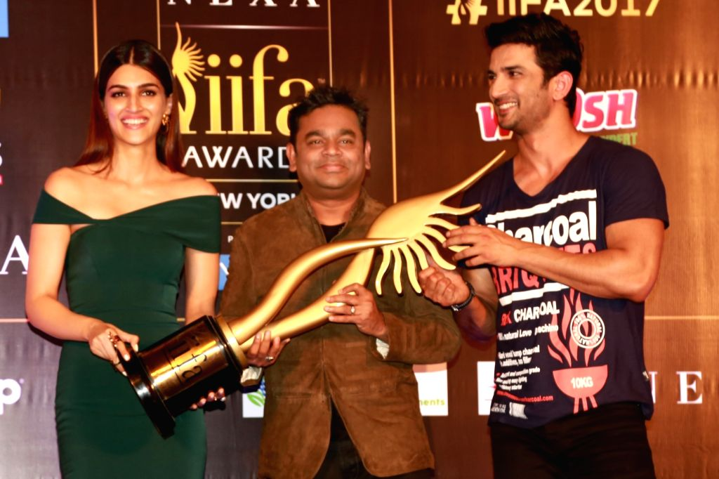 Actors Kriti Sanon and Sushant Singh Rajput with composer AR Rahman during a press conference regarding International Indian Film Academy (IIFA) Awards; in New Delhi on July 4, 2017. - Kriti Sanon and Sushant Singh Rajput