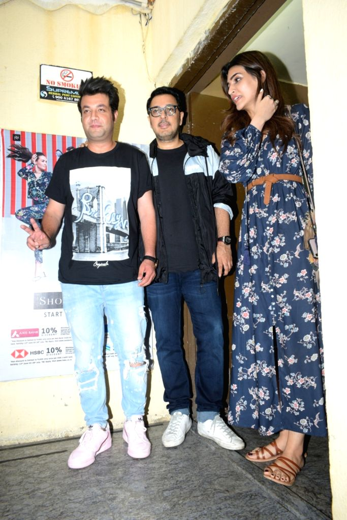 Actors Kriti Sanon and Varun Sharma with producer Dinesh Vijan seen at a Mumbai cinema hall on Aug 8, 2019. - Kriti Sanon and Varun Sharma