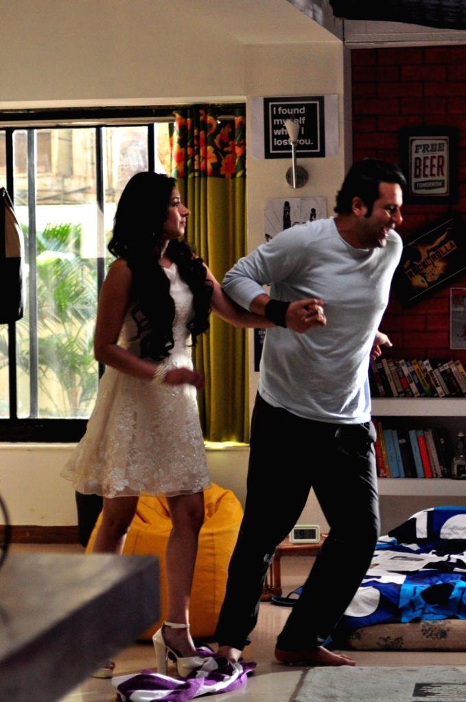 Actors Krushna Abhishek and Niharica Raizada during the on location shoot of film Full 2 Jugadu, in Mumbai on April 17, 2016. - Krushna Abhishek and Niharica Raizada
