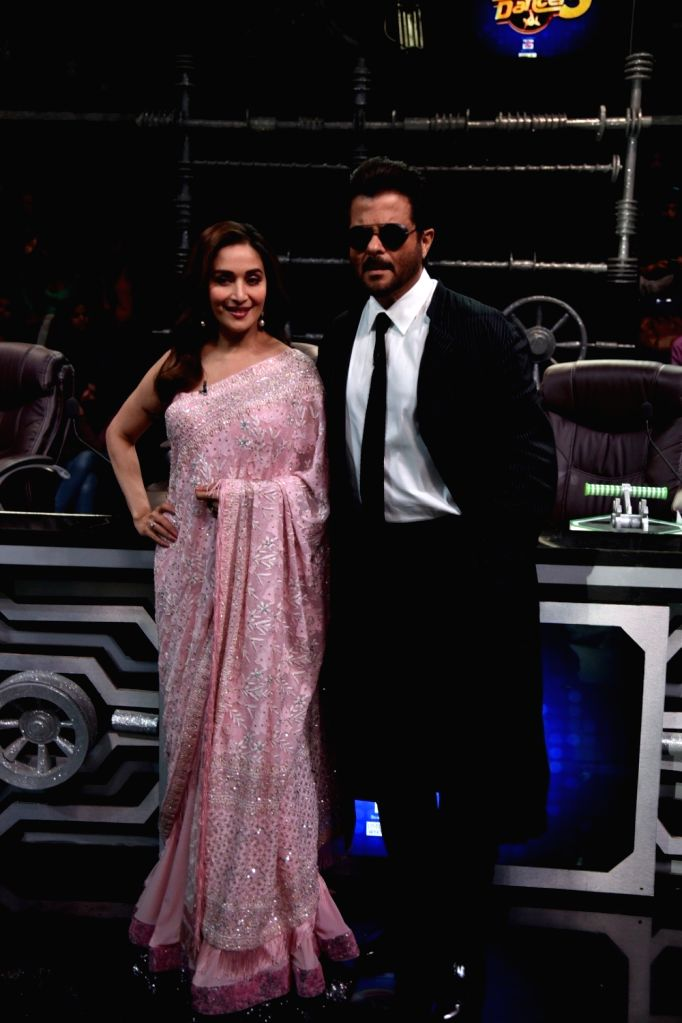 "Actors Madhuri Dixit and Anil Kapoor during the promotion of their upcoming film ""Total Dhamaal"" on the sets of Super Dancer Chapter 3 in Mumbai on Feb. 10, 2019. Also seen her ... - Madhuri Dixit and Anil Kapoor"