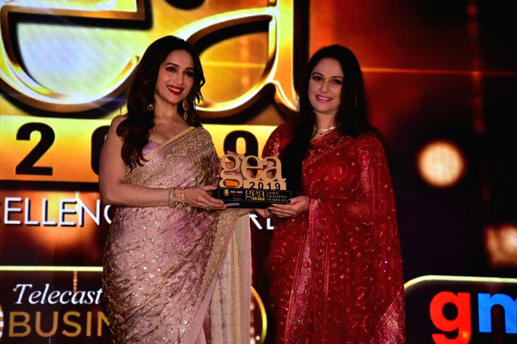 """Actors Madhuri Dixit and Gracy Singh at """"Global Excellence Awards 2019"""" in Mumbai on Oct 12, 2019. - Madhuri Dixit and Gracy Singh"""