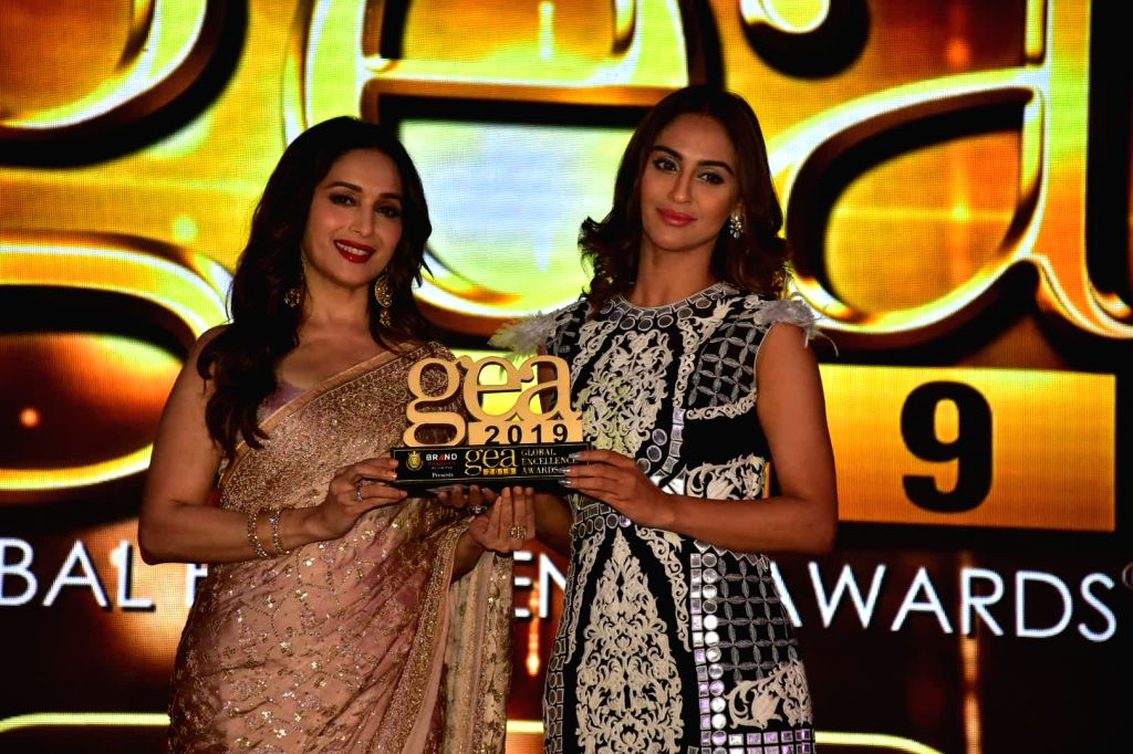 "Actors Madhuri Dixit and Krystle D'Souza at ""Global Excellence Awards 2019"" in Mumbai on Oct 12, 2019. - Madhuri Dixit and Krystle D"