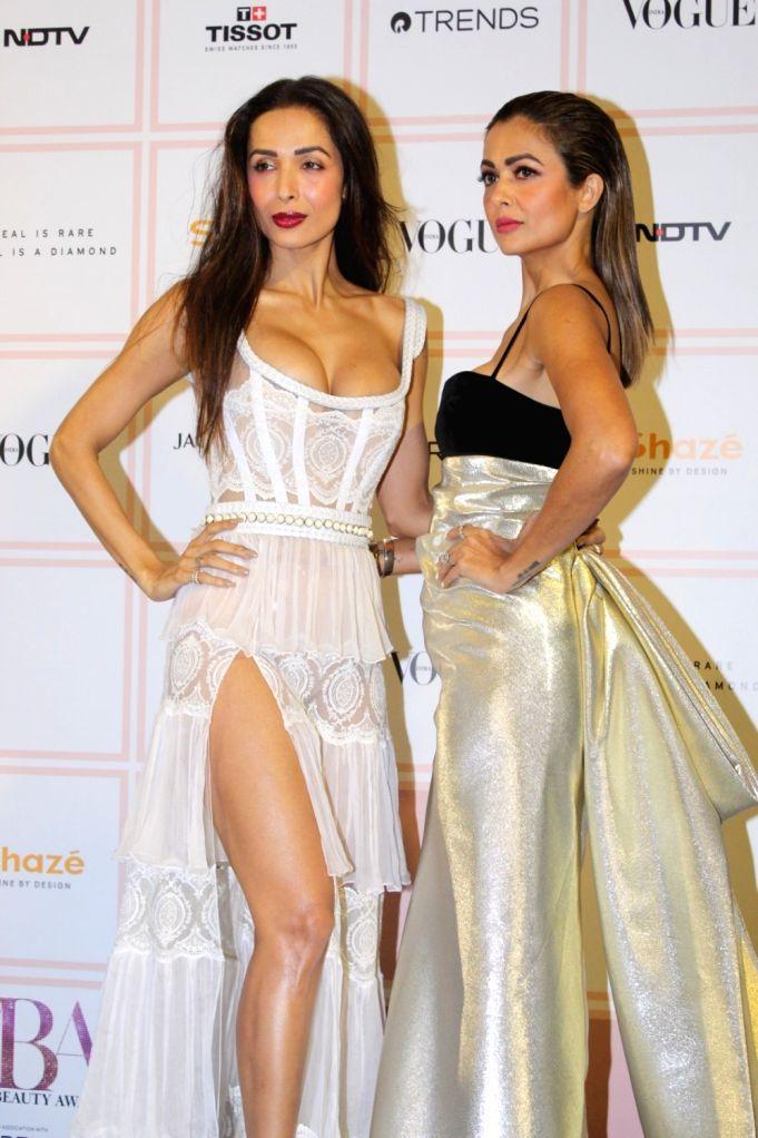 Actors Malaika Arora and Amrita Arora at 10th Vogue Beauty Awards in Mumbai on Sep 26, 2019. - Malaika Arora and Amrita Arora