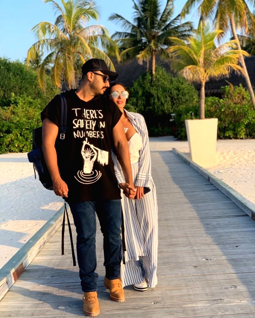 """Actors Malaika Arora and Arjun Kapoor have made their relationship official as the actress shared a romantic photograph with the """"Ishaqzaade"""" star on social media. (Photo: Instagram/malaikaaroraofficial) - Malaika Arora and Arjun Kapoor"""