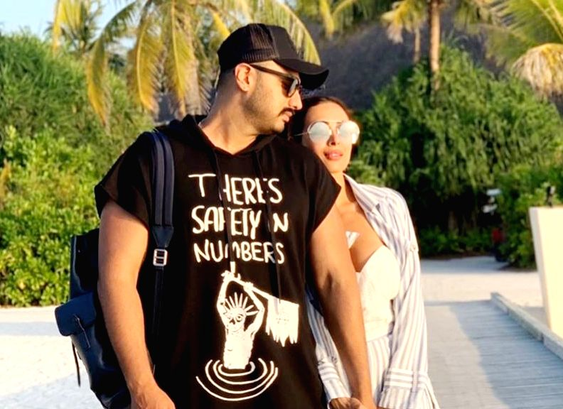 "Actors Malaika Arora and Arjun Kapoor have made their relationship official as the actress shared a romantic photograph with the ""Ishaqzaade"" star on social media. (Photo: Instagram/malaikaaroraofficial) - Malaika Arora and Arjun Kapoor"