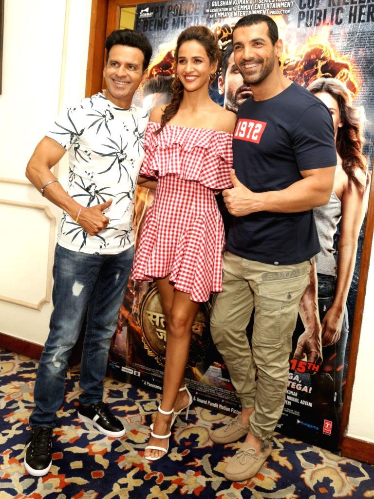 "Actors Manoj Bajpayee, Aisha Sharma and John Abraham during the promotion of their upcoming film ""Satyameva Jayate"" in New Delhi on Aug 9, 2018. - Manoj Bajpayee, Aisha Sharma and John Abraham"