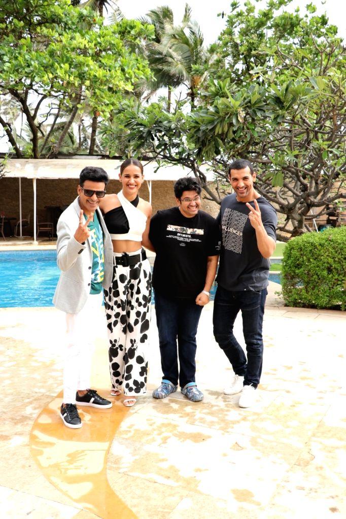"Actors Manoj Bajpayee, Aisha Sharma, John Abraham and director Milap Zaveri during the promotion of their upcoming film ""Satyameva Jayate"" in Mumbai on Aug 3, 2018. - Milap Zaveri, Manoj Bajpayee, Aisha Sharma and John Abraham"