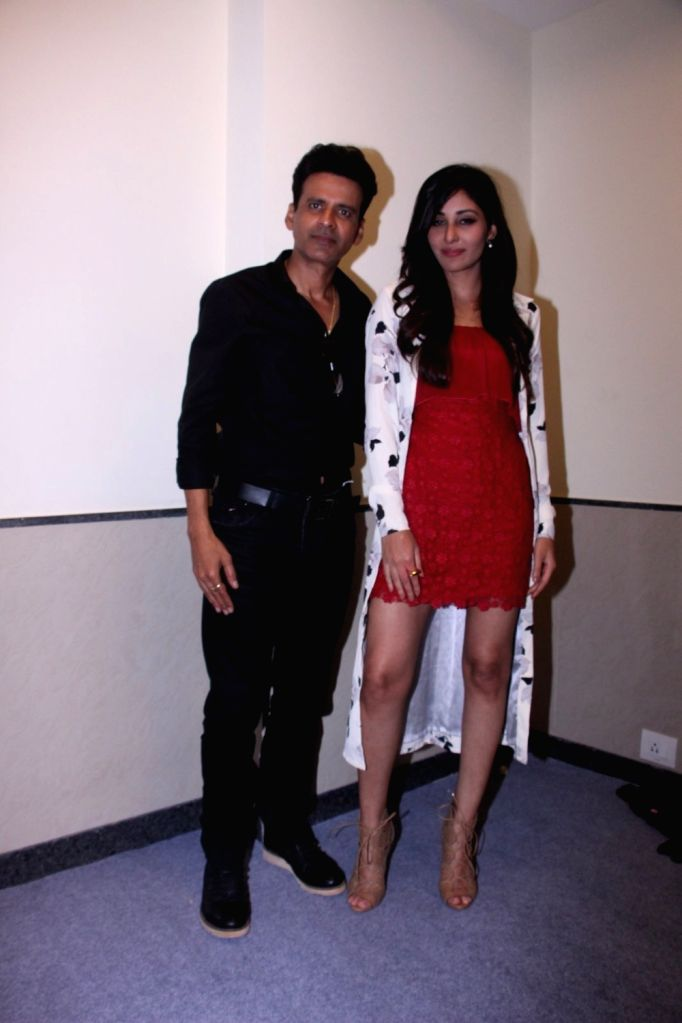 Actors Manoj Bajpayee and Pooja Chopra during the promotion of their short film Ouch at the Jio MAMI 18th Mumbai Film Festival, in Mumbai on Oct 22, 2016. - Manoj Bajpayee and Pooja Chopra