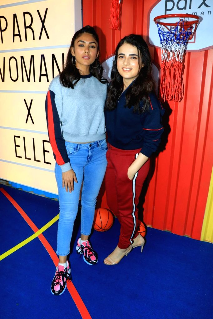 Actors Mrunal Thakur and Radhika Madan at the launch of Parx Women X Elle New Collection 'The Winter Games' in Mumbai on Sep 26, 2019. - Mrunal Thakur and Radhika Madan