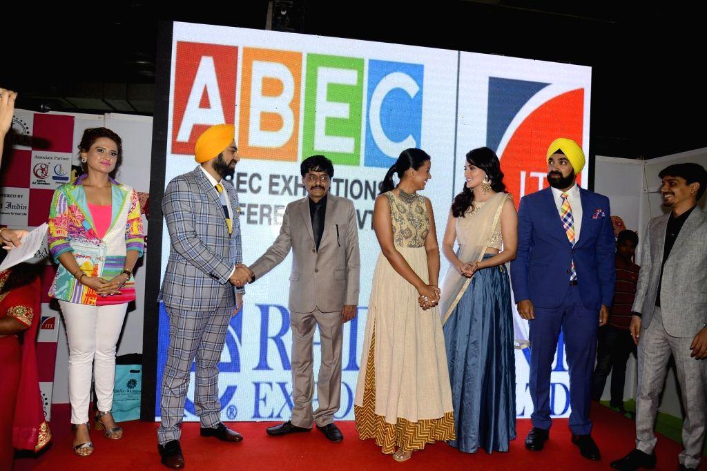 Actors Mugdha Godse and Mandana Karim during the jewellery exhibition at Bombay Exhibition Centre, NESCO, in Mumbai, on Aug 20, 2016. - Mugdha Godse and Mandana Karim