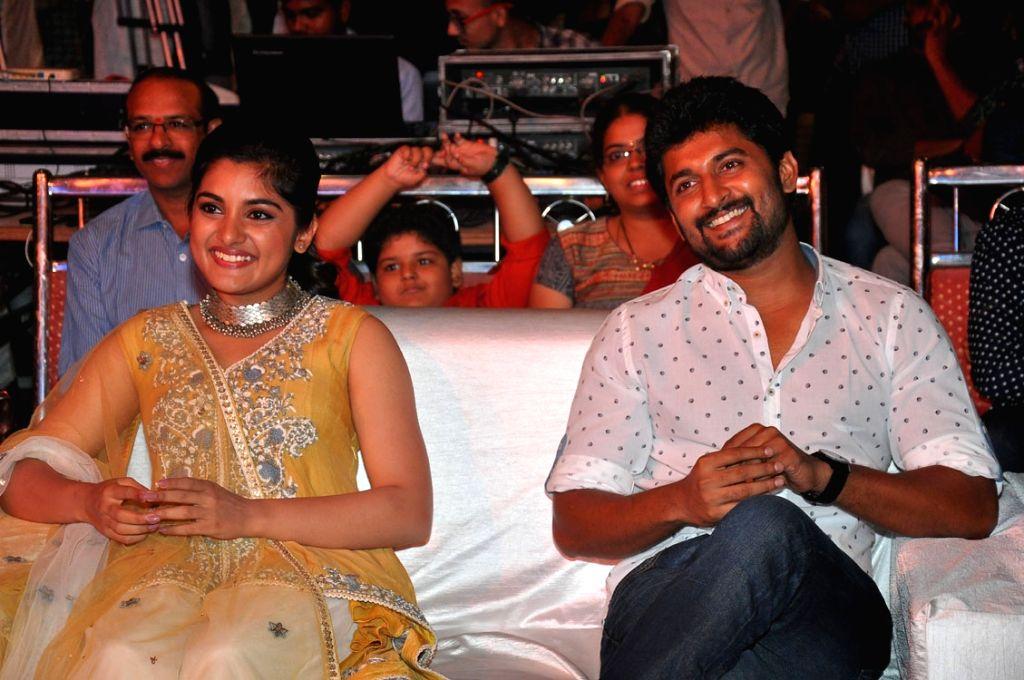 "Actors Nivedita Thomas and Nani during the pre release function of Telugu movie ""Ninnu Kori"" in Hyderabad. - Nivedita Thomas and Nani"