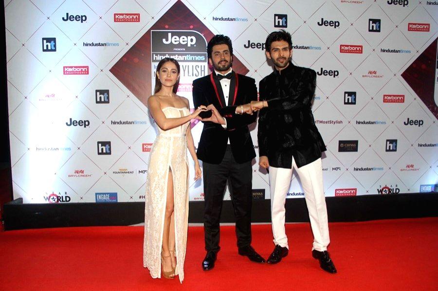 "Actors Nushrat Bharucha, Sunny Singh and Kartik Aaryan at the red carpet of ""HT India's Most Stylish Awards"" in Mumbai on Jan 24, 2018. - Nushrat Bharucha, Sunny Singh and Kartik Aaryan"