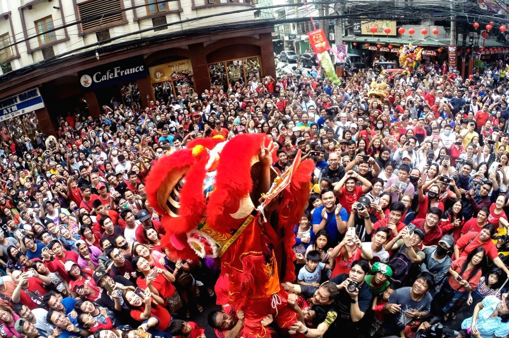 Actors perform lion dance during the celebrations of the Chinese Lunar New Year in the Chinatown of Manila, the Philippines, Jan. 25, 2020.