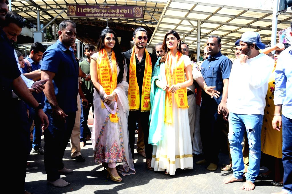 """Actors Pooja Sawant and Vidyut Jamwal with model Asha Bhat during their visit to Siddhivinayak Temple ahead of the trailer launch of their upcoming film """"Junglee"""" in Mumbai, on ... - Asha Bhat, Pooja Sawant and Vidyut Jamwal"""