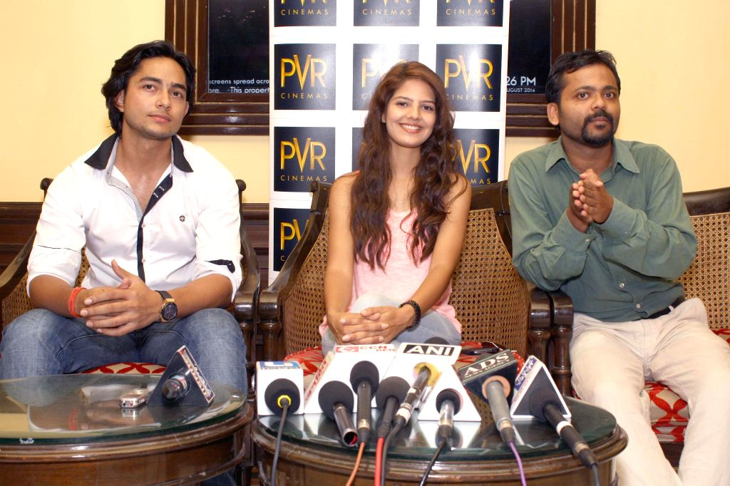 Actors Poonam Pandey and Manish Chaudhary during a press conference to promote their upcoming film `Trip To Bhangarh` in New Delhi on Aug 22, 2014. - Poonam Pandey and Manish Chaudhary