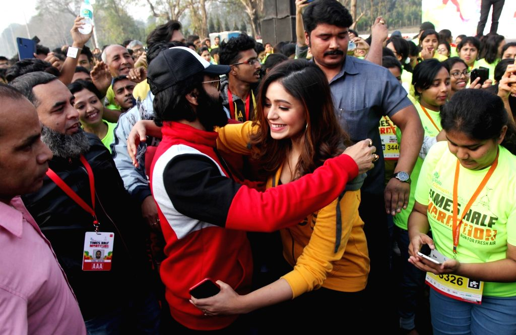 Actors Prasenjit Chatterjee and Ritabhari Chakraborty during Half Marathon run in Kolkata on Feb 9, 2020. - Prasenjit Chatterjee and Ritabhari Chakraborty