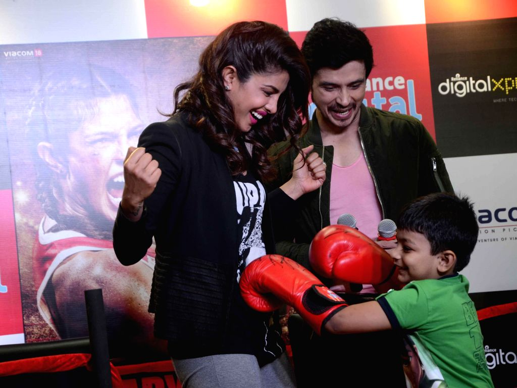 Actors Priyanka Chopra and Darshan Kumaar during a press conference to promote their film 'Mary Kom' in Mumbai on Sept 11, 2014. - Priyanka Chopra and Darshan Kumaar