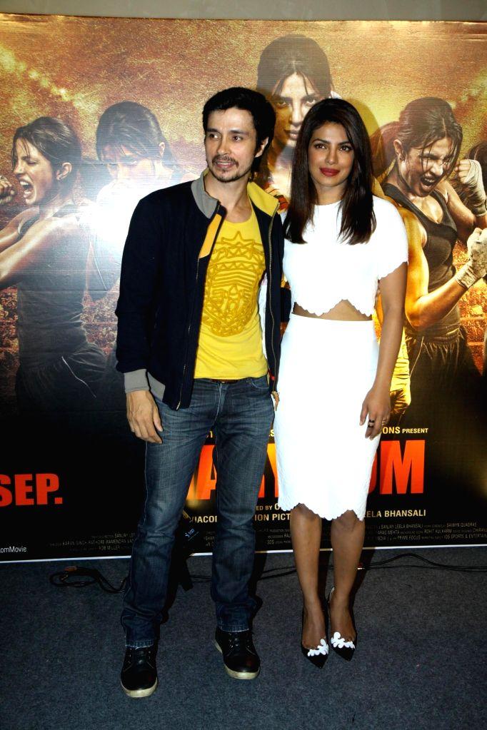 Actors Priyanka Chopra and Darshan Kumar during the unveiling of the trailer of film Mary Kom in Mumbai on July 23, 2014. - Priyanka Chopra and Darshan Kumar