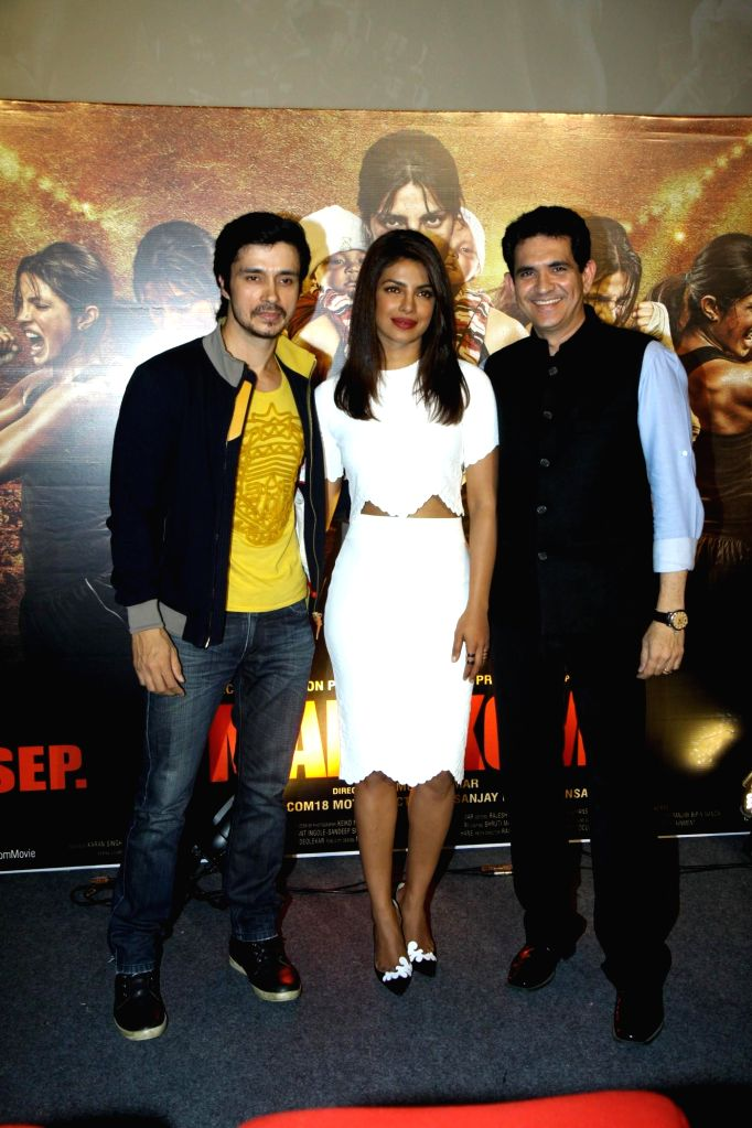 Actors Priyanka Chopra, Darshan Kumar and filmmaker Omung Kumar during the unveiling of the trailer of film Mary Kom in Mumbai on July 23, 2014. - Priyanka Chopra, Darshan Kumar and Omung Kumar