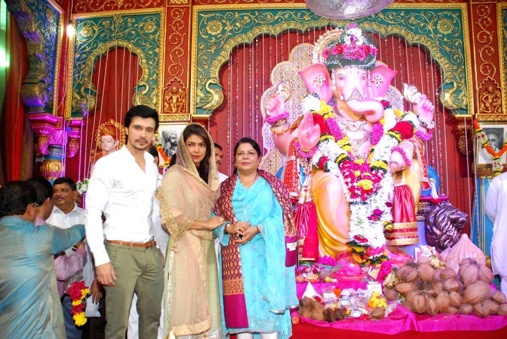 Actors Priyanka Chopra with Darshan Kumar and her mother at Andhericha Raja Ganesh Pandal in Mumbai on 10 Sept, 2014.